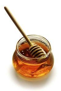 Honigglas mit Honiglöffel